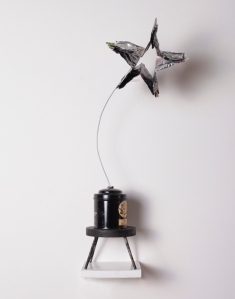 Shooting Star, 2012, Recycled aluminum cans, wire, rivets, stand, 24 inches, x 5 inches x 5 inches